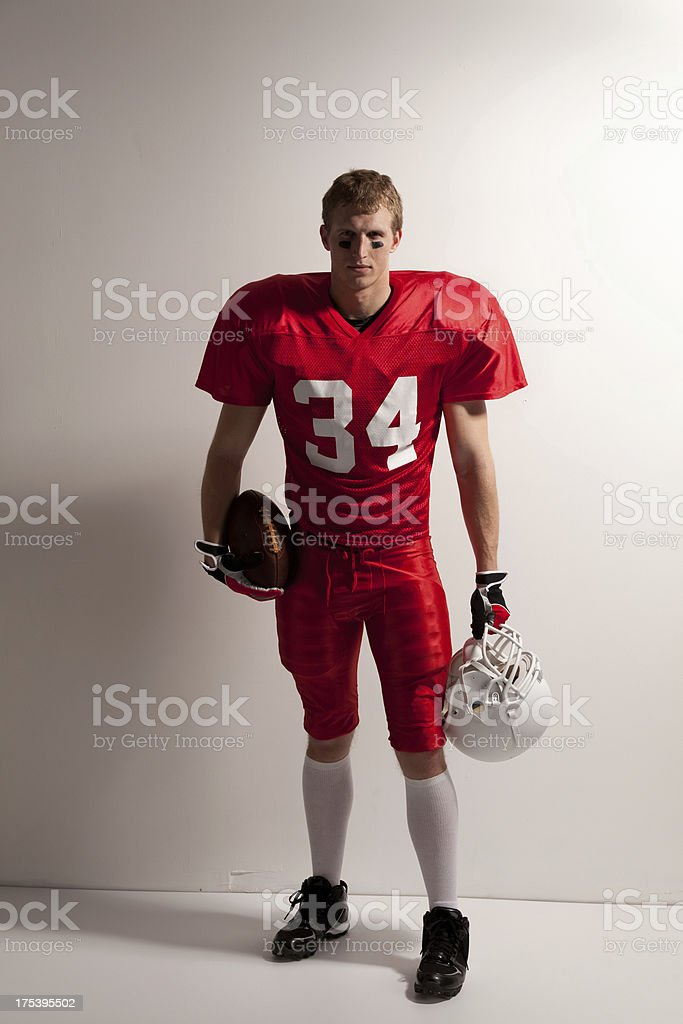 Portrait of a sportsman with an American football stock photo
