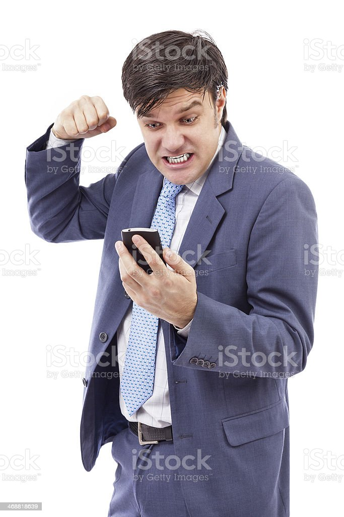 Portrait of a stressed businessman getting bad news by phone stock photo