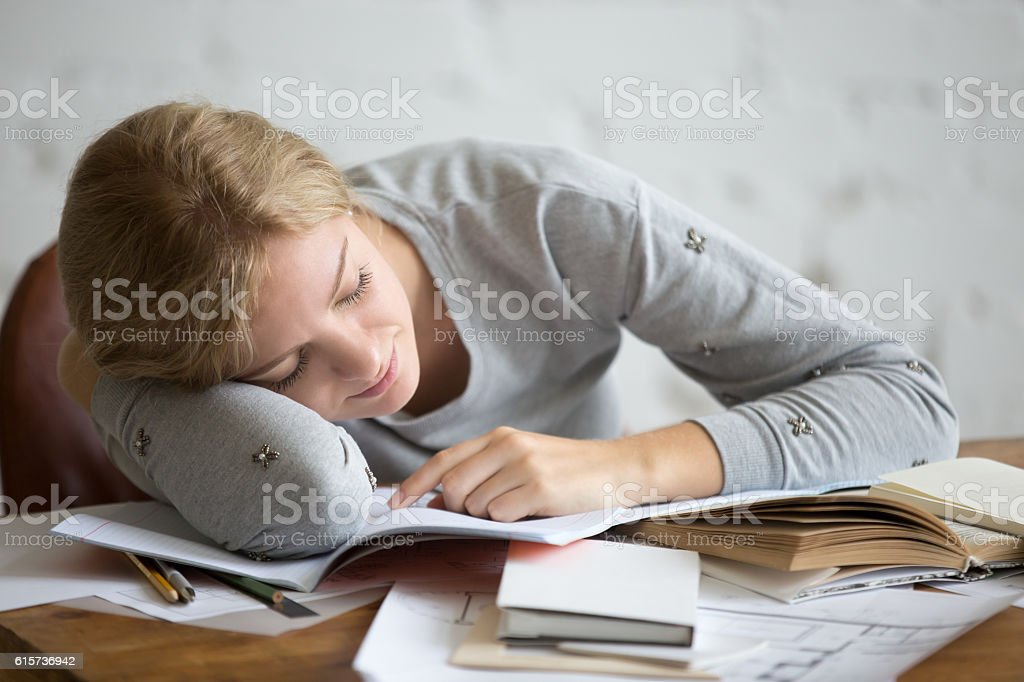 Portrait of a student girl sleeping at the desk stock photo