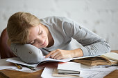 Portrait of a student girl sleeping at the desk