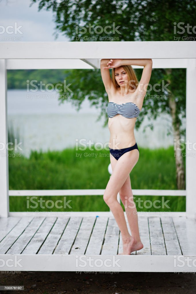 Portrait of a stunning young female model posing at summer stock photo