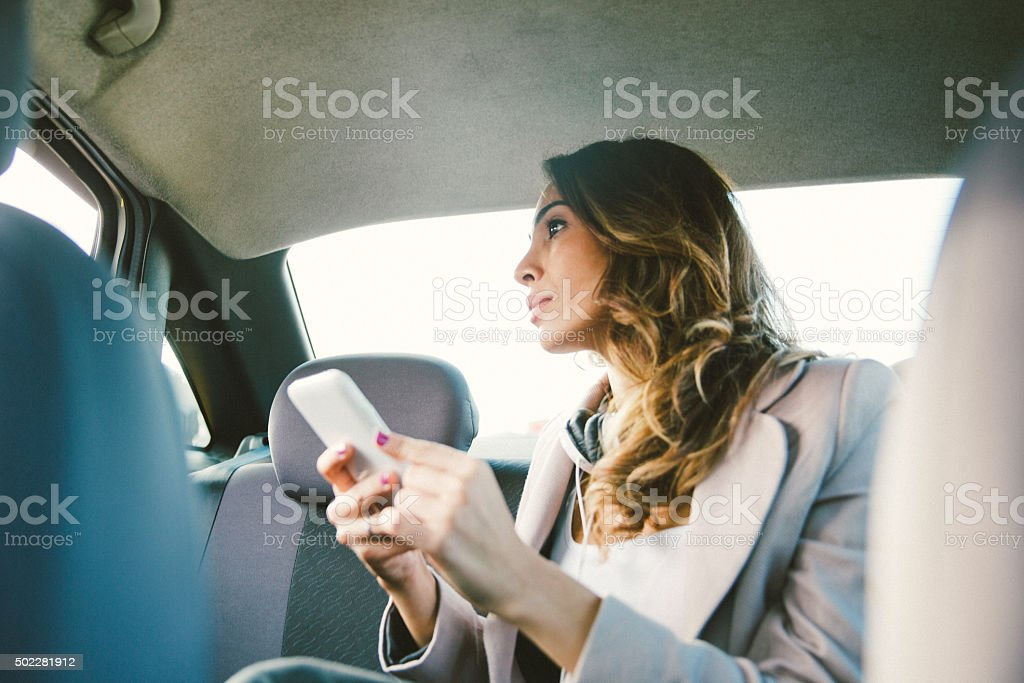 Portrait Of A Successful Businesswoman In A Taxi stock photo