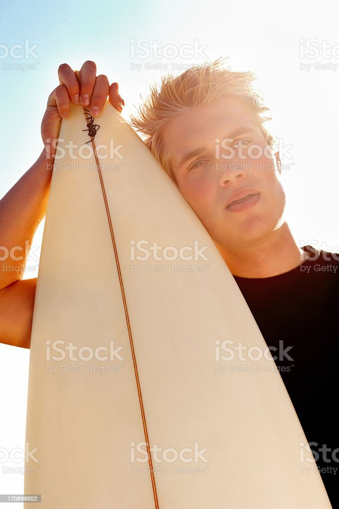 Portrait of a surfer with surfboard royalty-free stock photo