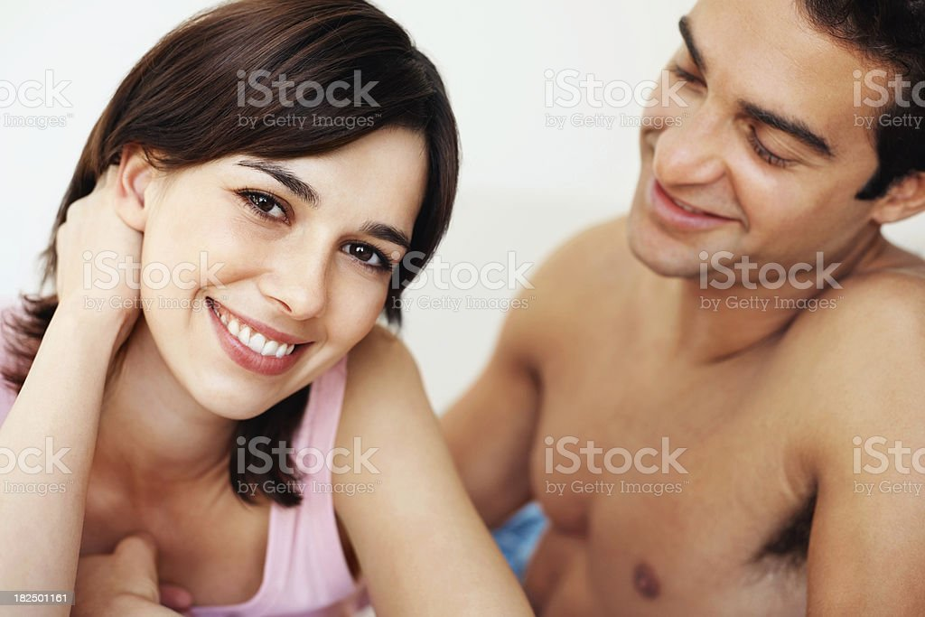 Portrait of a sweet young couple smiling together royalty-free stock photo