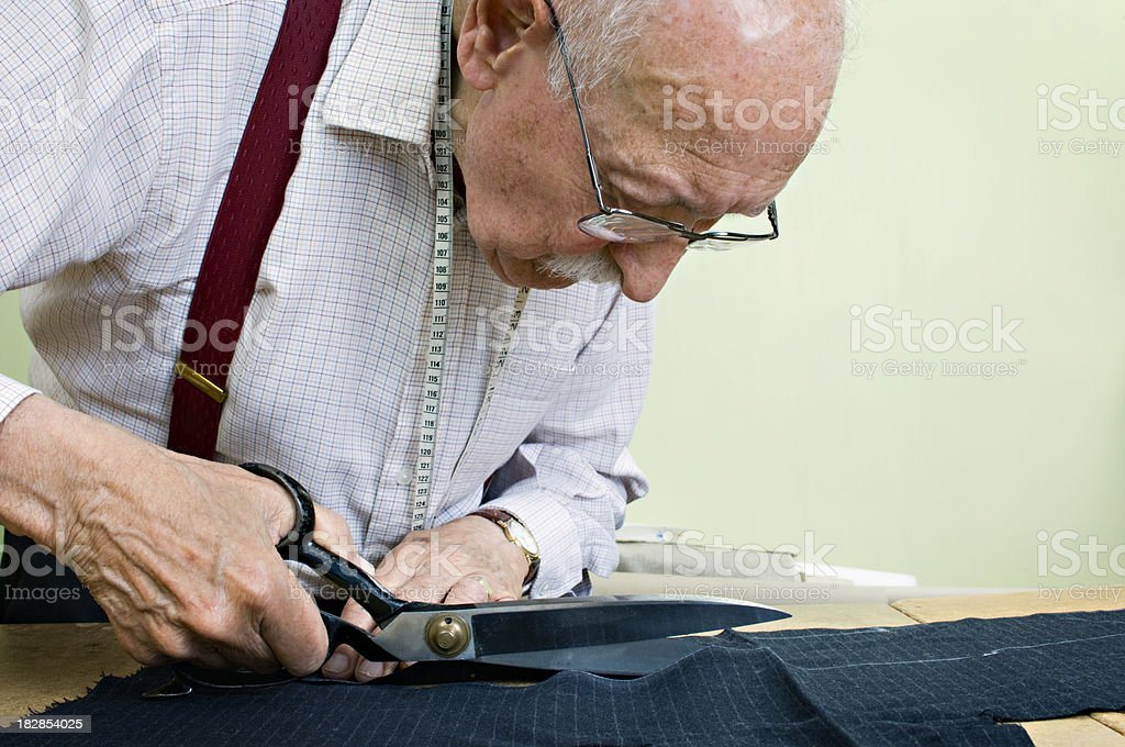 Portrait of a Tailor Working on a Suit royalty-free stock photo