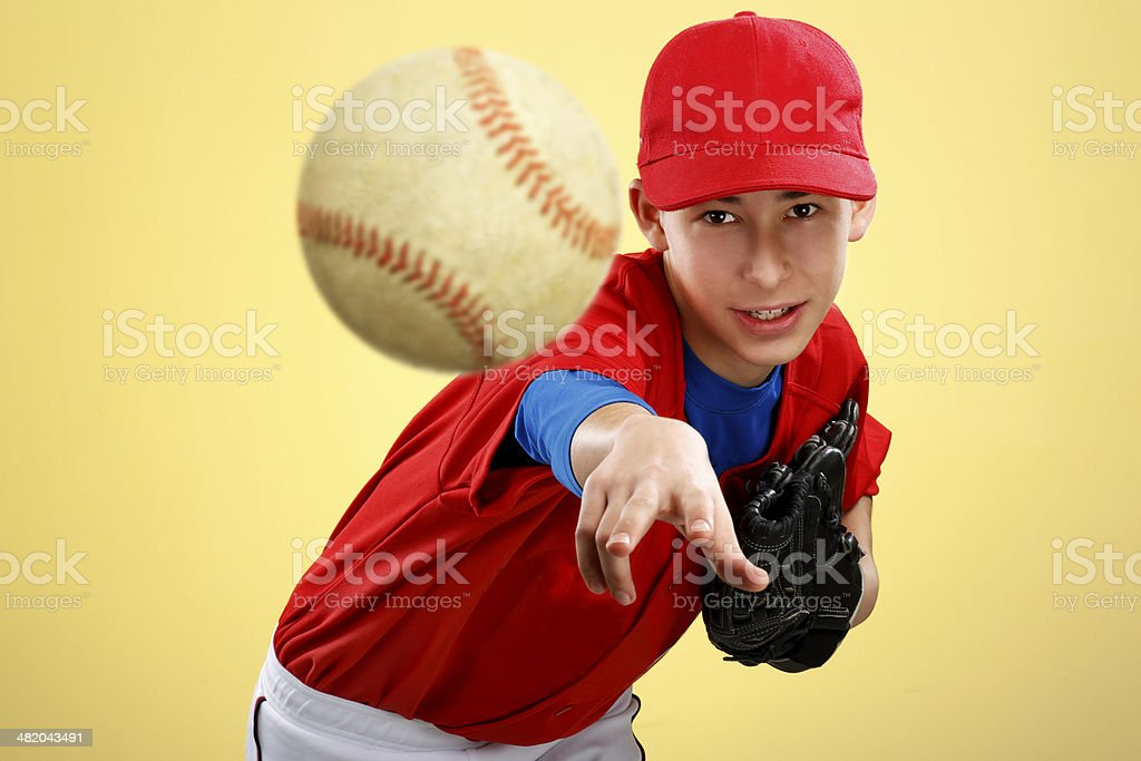 portrait of a  teen baseball player in red uniform stock photo