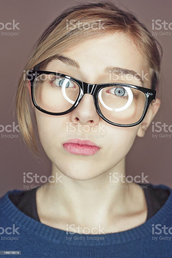 portrait of a teen girl with glasses stock photo
