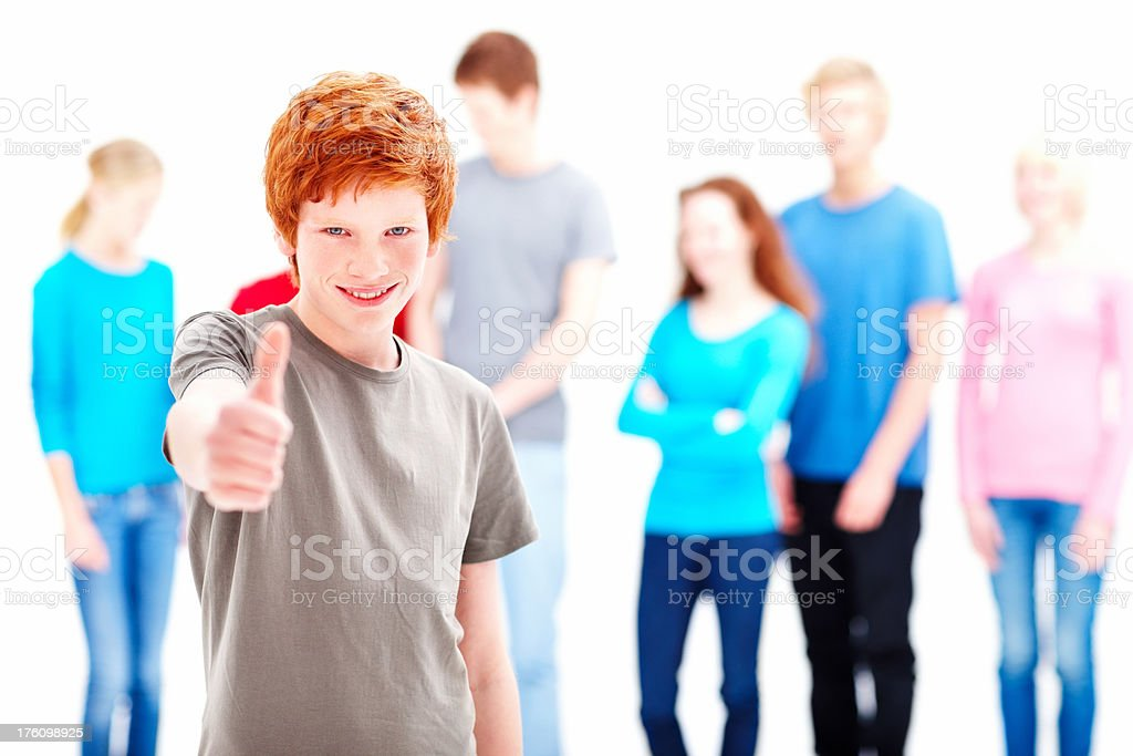 Portrait of a teenage boy showing thumbs up sign royalty-free stock photo