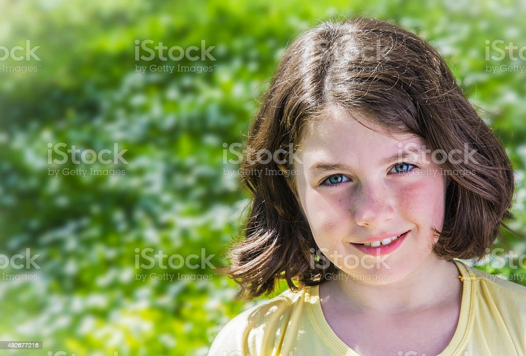 Portrait of a teenage girl smiling royalty-free stock photo