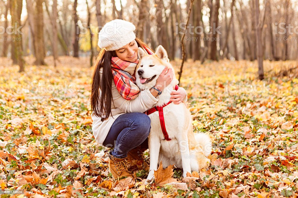 Portrait of a teenage girl with her beautiful dog outdoors stock photo
