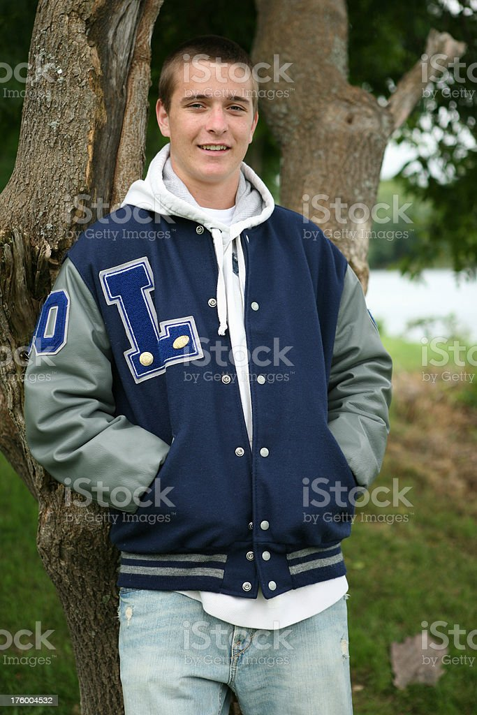 portrait of a teenager with letter jacket stock photo