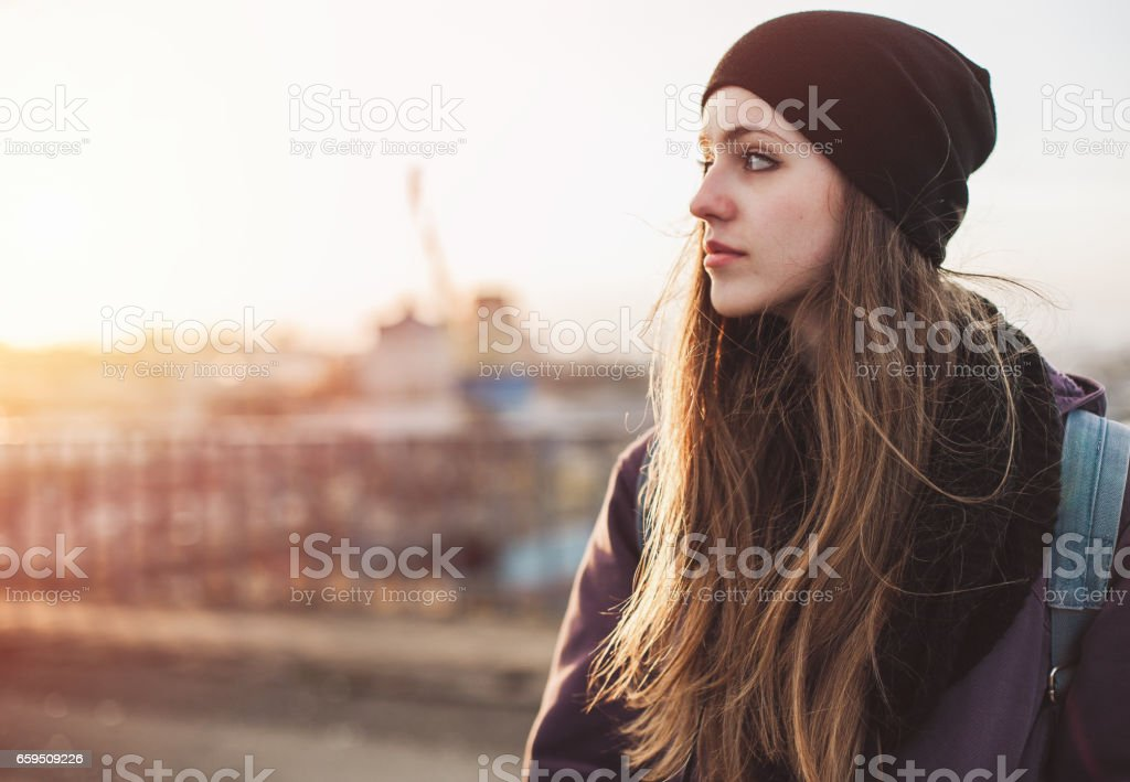 Portrait of a thoughtful girl traveler stock photo