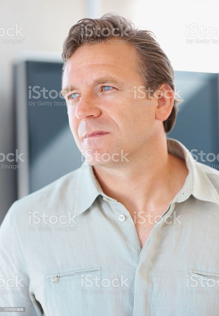 Portrait of a thoughtful mature man looking away stock photo