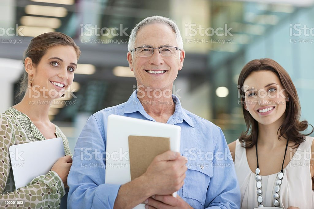 Portrait of a three smiling architect standing in office royalty-free stock photo