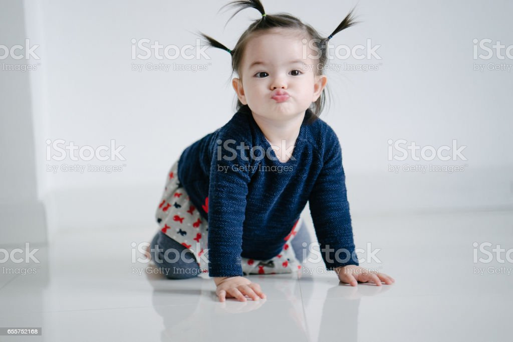 Portrait of a toddler girl kissing stock photo