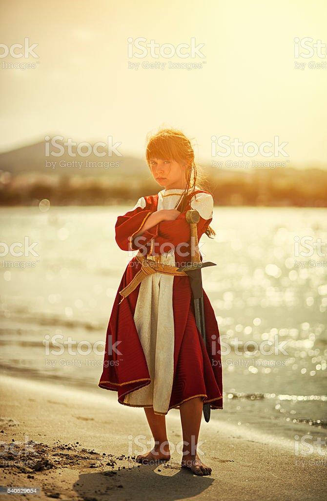 Portrait of a  tough little viking shieldmaiden stock photo