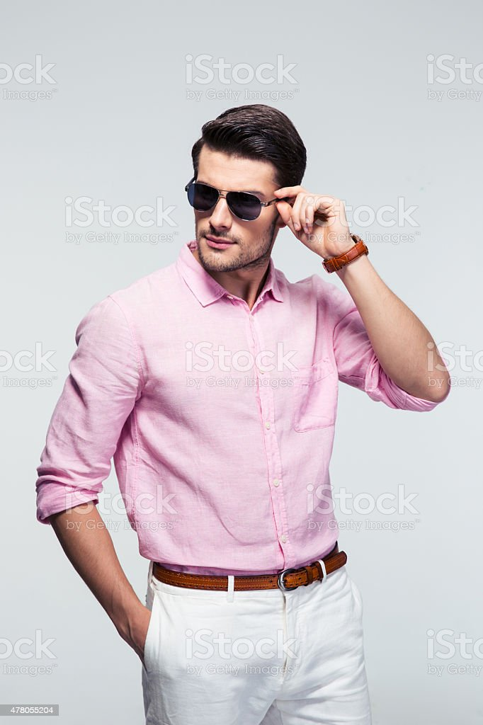 Portrait of a trendy young man in sunglasses stock photo