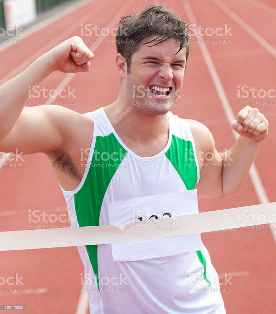 portrait of a victorious sprinter passing the arrival line royalty-free stock photo