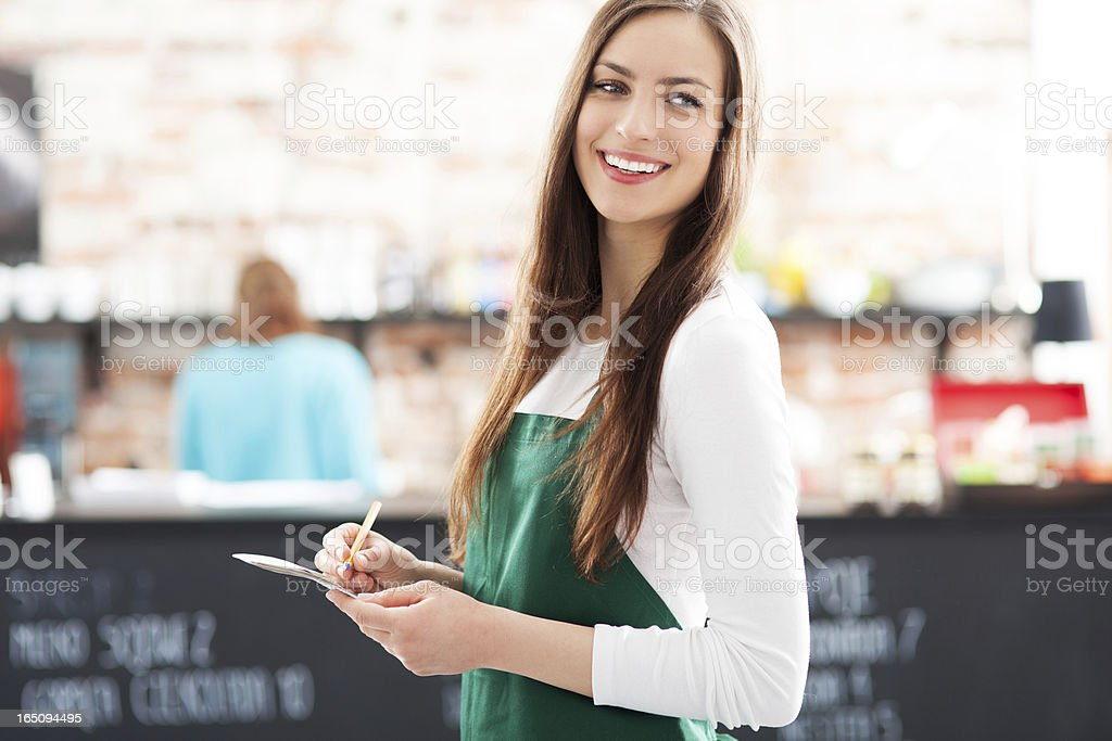 A portrait of a waitress in a cafe stock photo