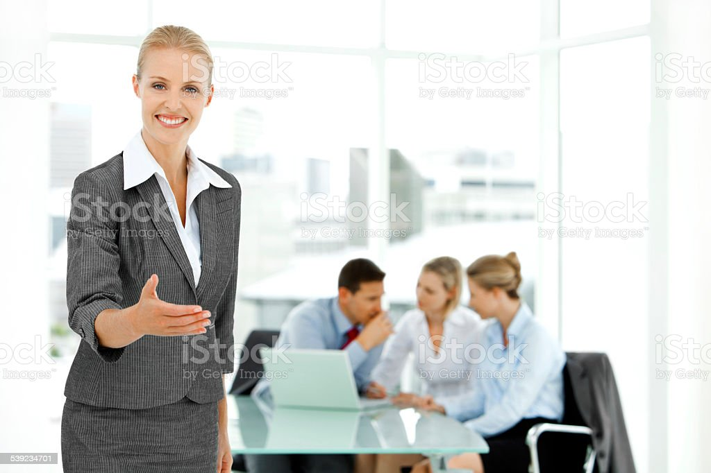 Portrait of a welcoming Businesswoman stock photo