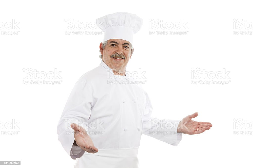 Portrait of a welcoming cook in  chefs hat and uniform royalty-free stock photo
