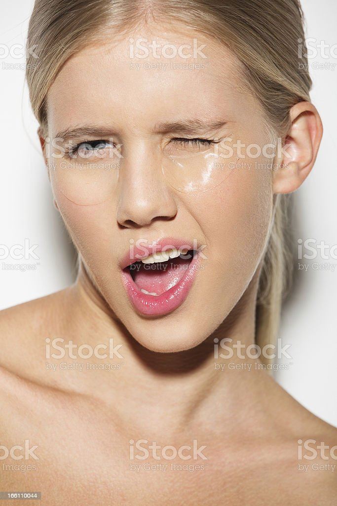 portrait of a winking girl wearing eye patches royalty-free stock photo