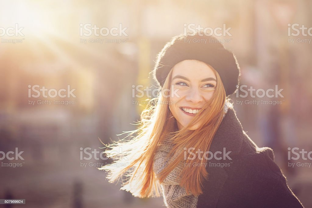 Portrait of a woman at sunlight stock photo