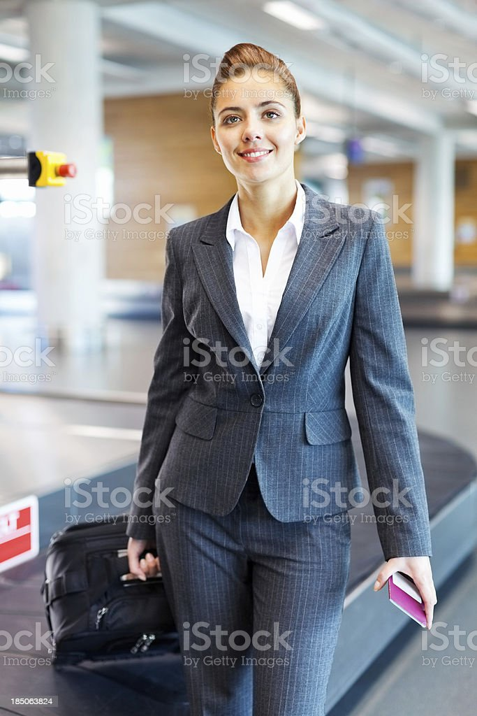 Portrait Of a Woman Collecting Her Luggage royalty-free stock photo