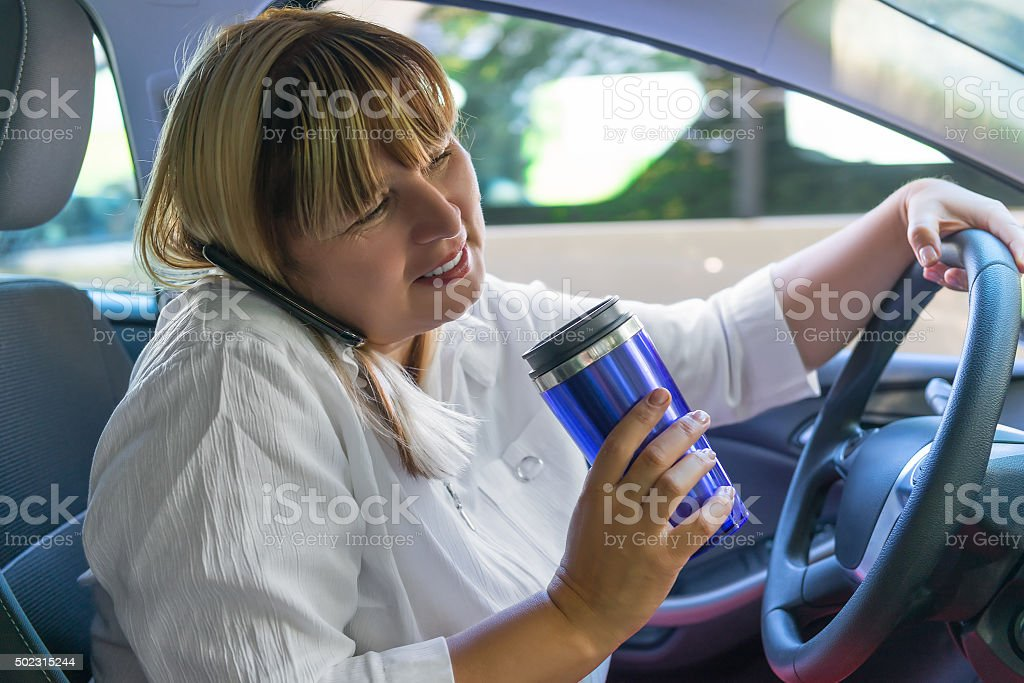 portrait of a woman driving a car stock photo