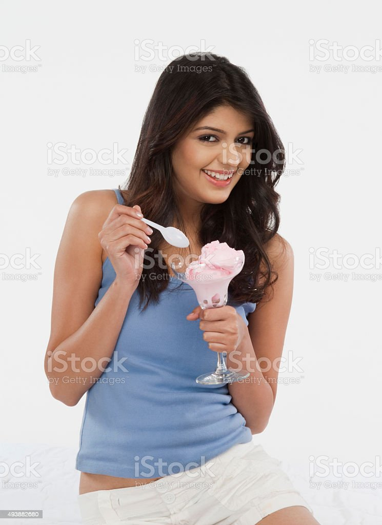 Portrait of a woman eating ice cream stock photo
