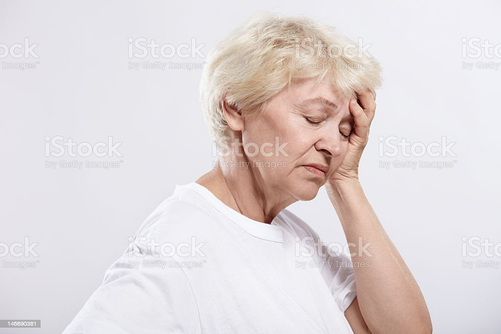 Portrait of a woman experiencing a migraine stock photo