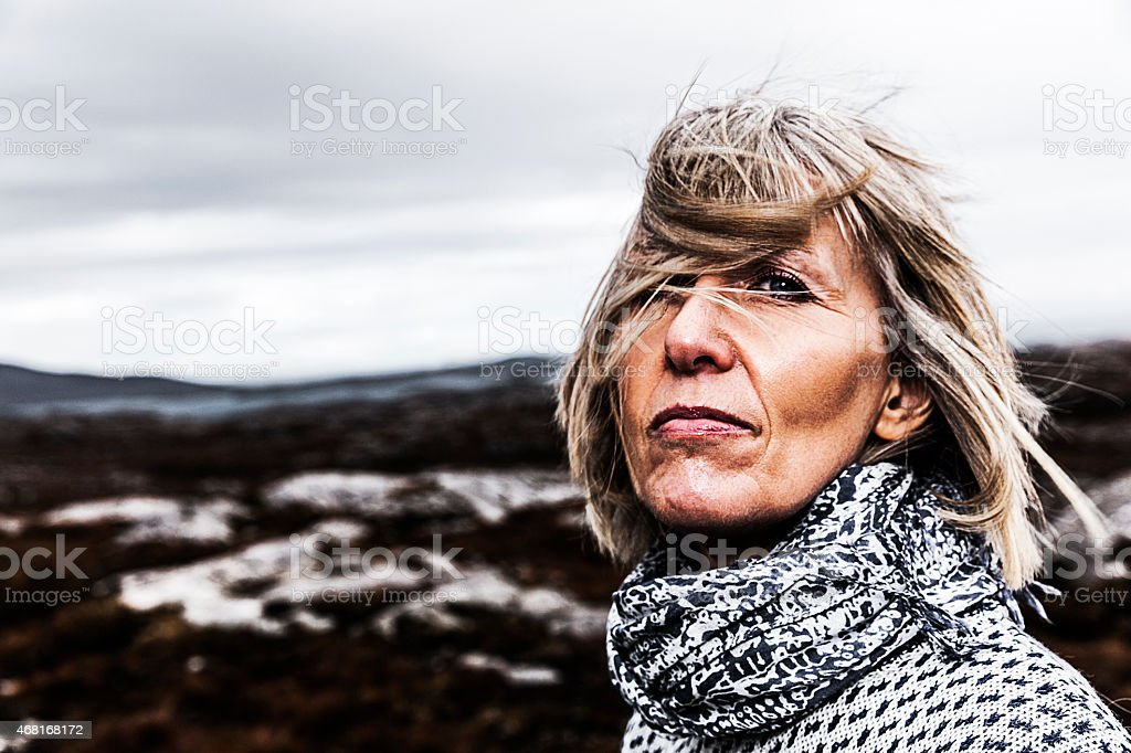 Portrait of a woman in a barren landscape stock photo