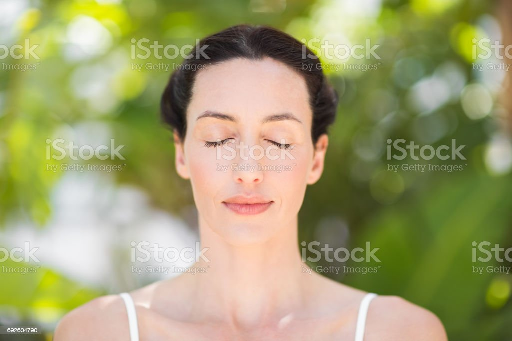 Portrait of a woman in a meditation position stock photo