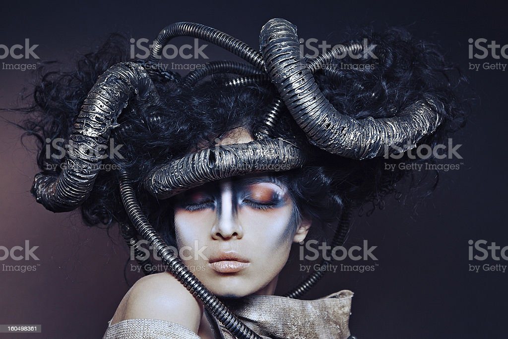 Portrait of a woman in dramatic makeup and costume stock photo