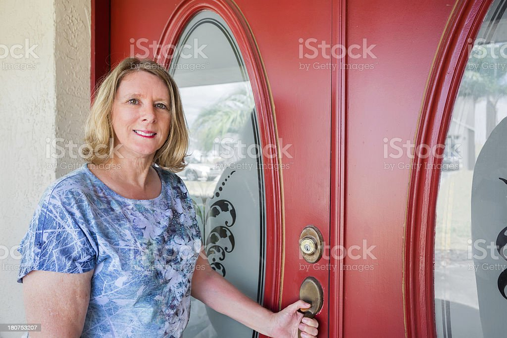 A portrait of a woman in front of the door royalty-free stock photo