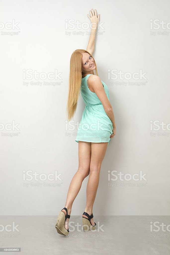 Portrait of a woman in green dress stock photo