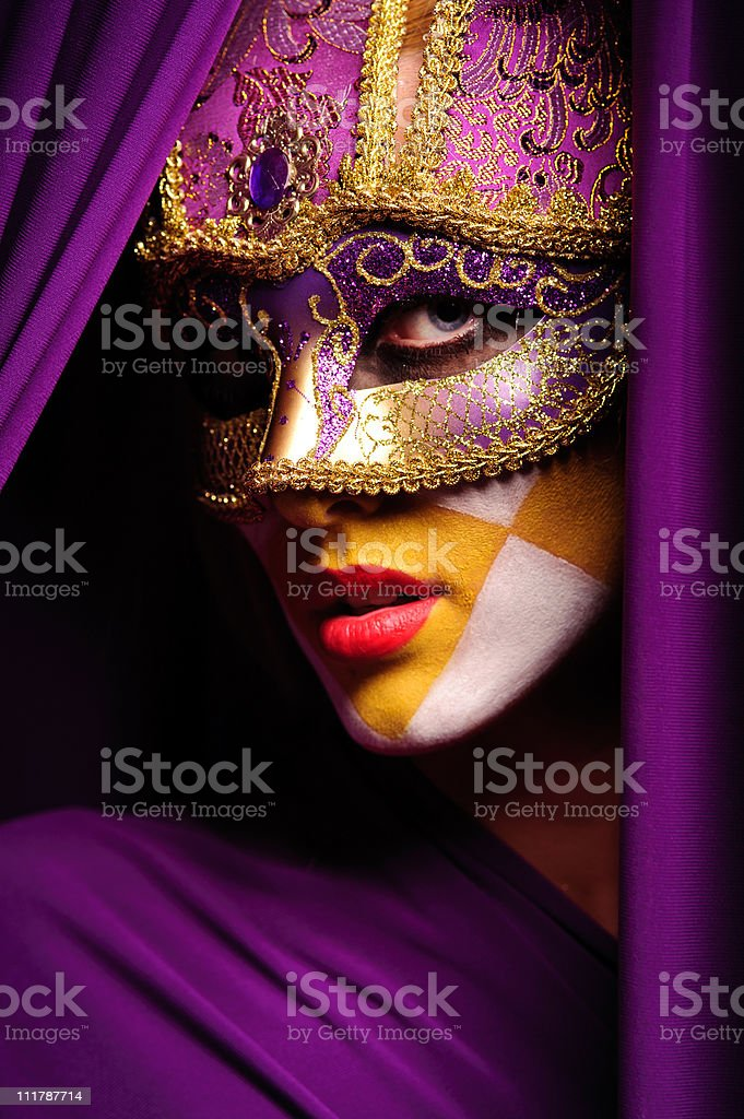 Portrait of a woman in violet masquerade mask stock photo