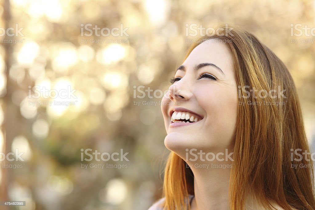 Portrait of a woman laughing with a perfect teeth stock photo