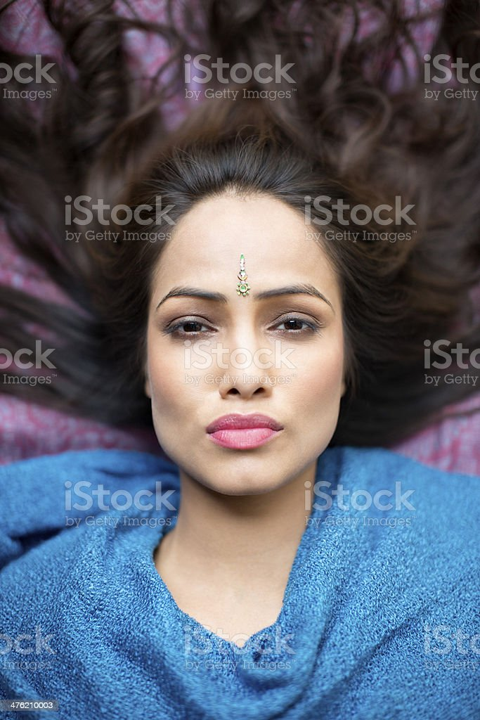Portrait of a woman lying down stock photo