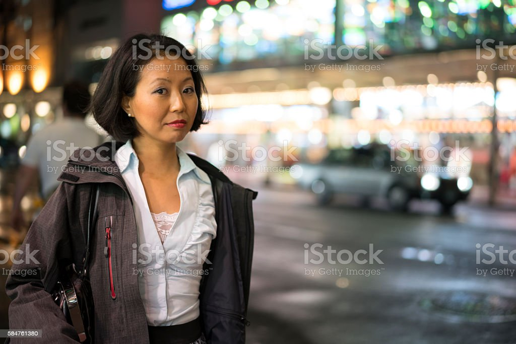 Portrait of a woman on markert street in Kyoto, Japan. stock photo