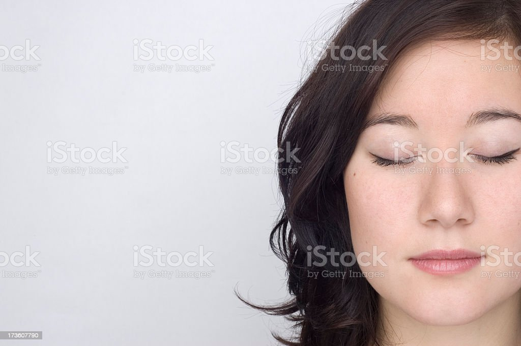 Portrait of a woman on the right side with her eyes closed stock photo