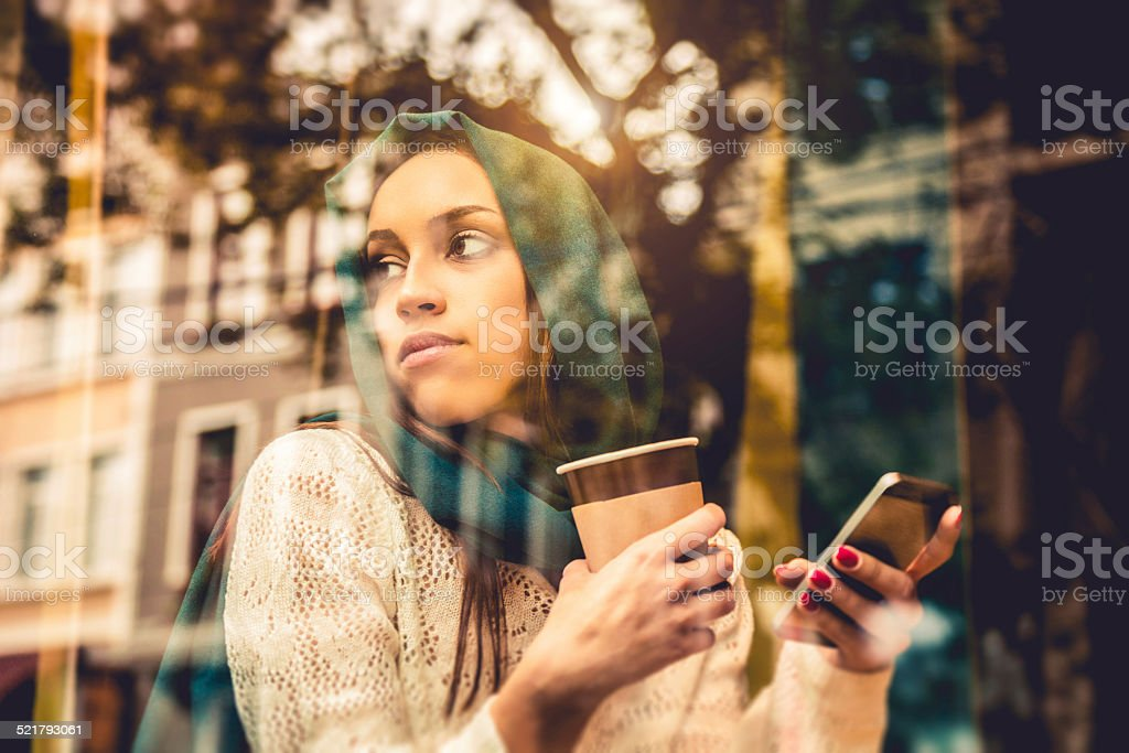 Portrait of a woman on the window of a cafe stock photo