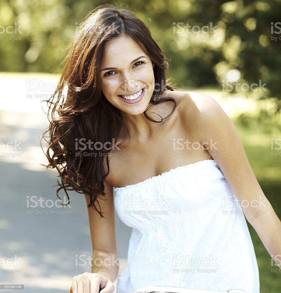 Portrait of a woman riding bicycle in park stock photo