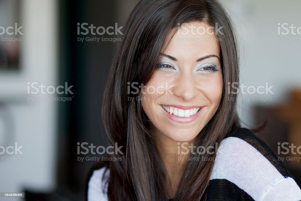 Portrait of a woman smiling and looking away stock photo