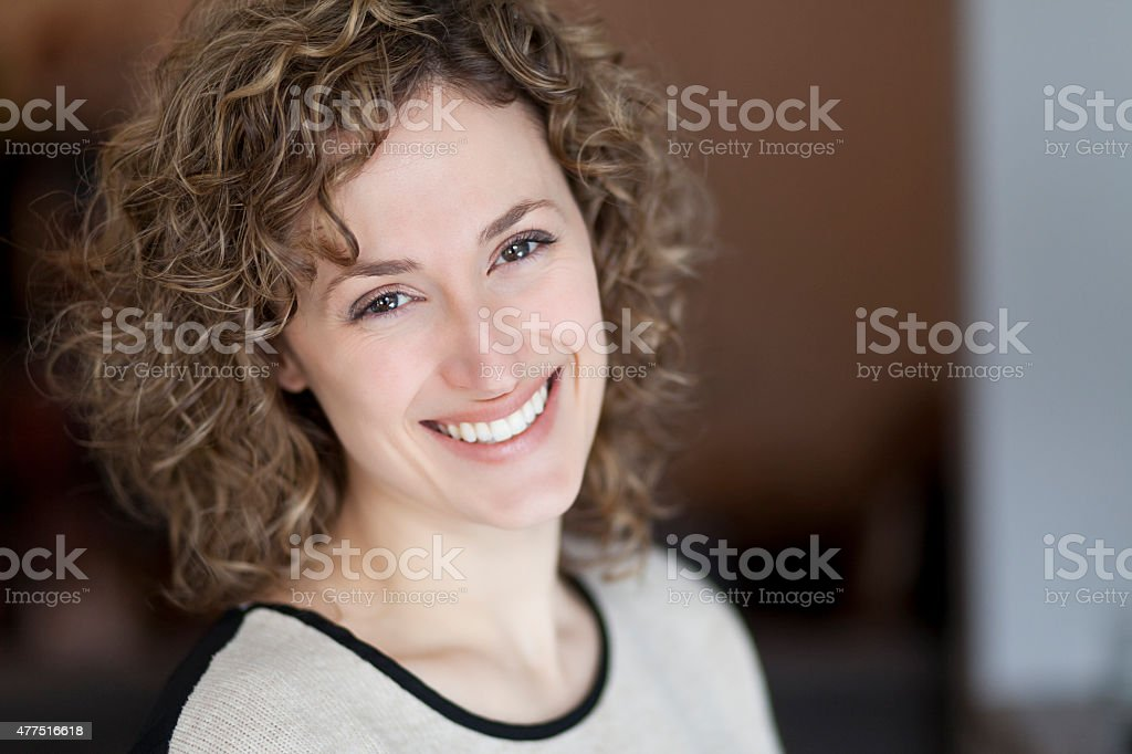 Portrait of a woman smiling at the camera stock photo