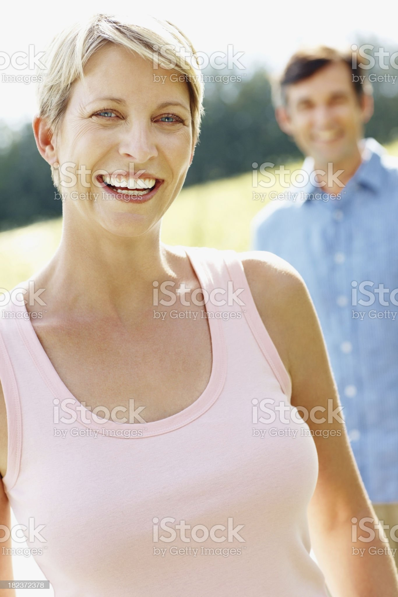 Portrait of a woman smiling with husband at the back royalty-free stock photo
