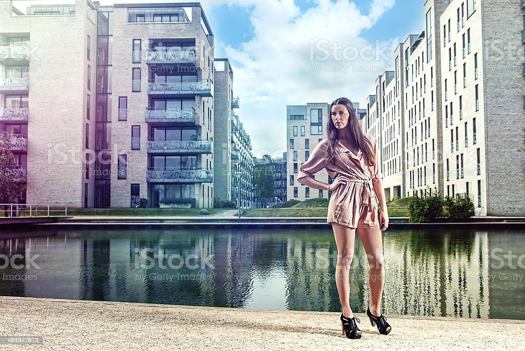 Portrait of a woman standing in new residential area stock photo