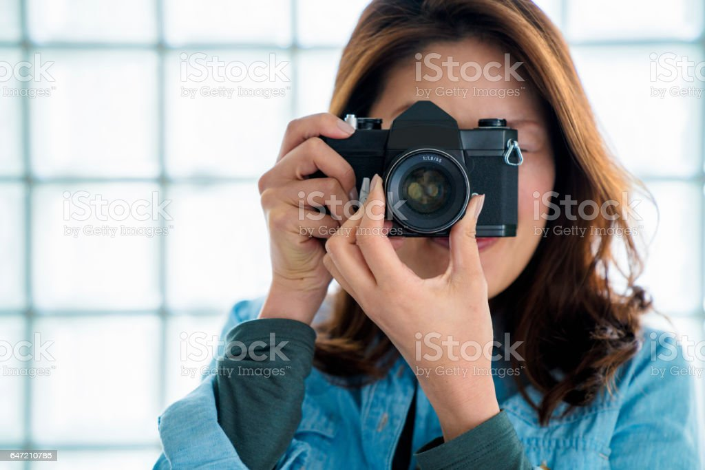 Portrait of a woman taking a photo stock photo