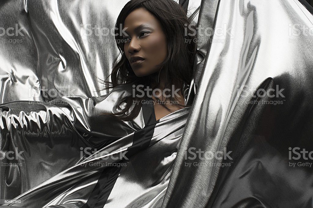 Portrait of a woman wearing silver dress stock photo
