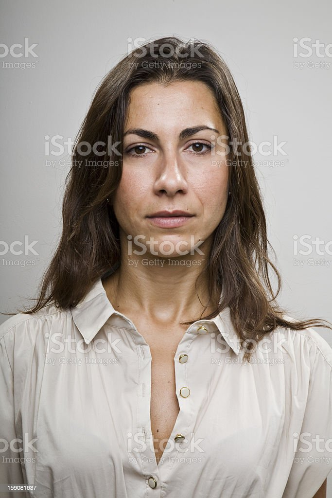 A portrait of a woman with a serious face stock photo
